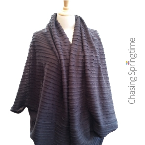 Grey Wool Blend Ripple Shrug by Chasing Springtime on white background w Logo fo web and A Plus mkt-01